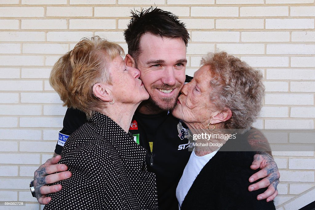 Retiring Dane Swan of the Magpies gets a kiss from his two grandmothers Betty and Moira during a Collingwood Magpies AFL media session at the Holden Centre on August 23, 2016 in Melbourne, Australia.
