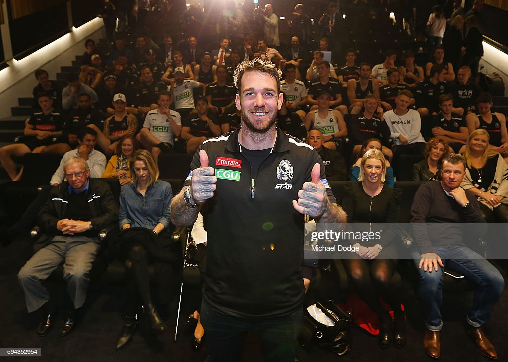 Retiring Dane Swan of the Magpies poses with club staff behind during a Collingwood Magpies AFL media session at the Holden Centre on August 23, 2016 in Melbourne, Australia.