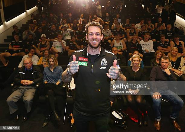 Retiring Dane Swan of the Magpies poses with club staff behind during a Collingwood Magpies AFL media session at the Holden Centre on August 23 2016...