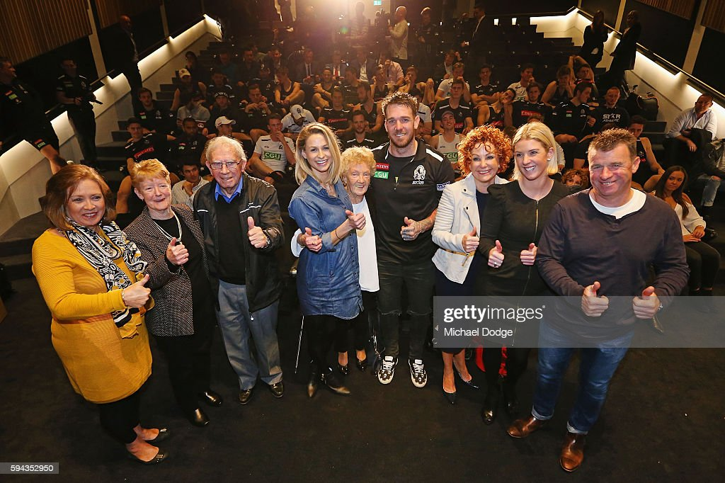 Retiring Dane Swan of the Magpies poses with family and club staff behind during a Collingwood Magpies AFL media session at the Holden Centre on August 23, 2016 in Melbourne, Australia.