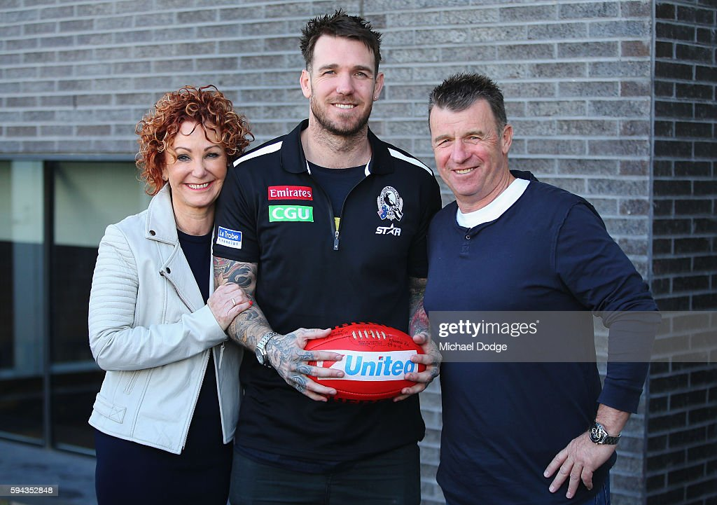 Retiring Dane Swan of the Magpies poses with mum Deidre Swan and dad Billy Swan during a Collingwood Magpies AFL media session at the Holden Centre on August 23, 2016 in Melbourne, Australia.