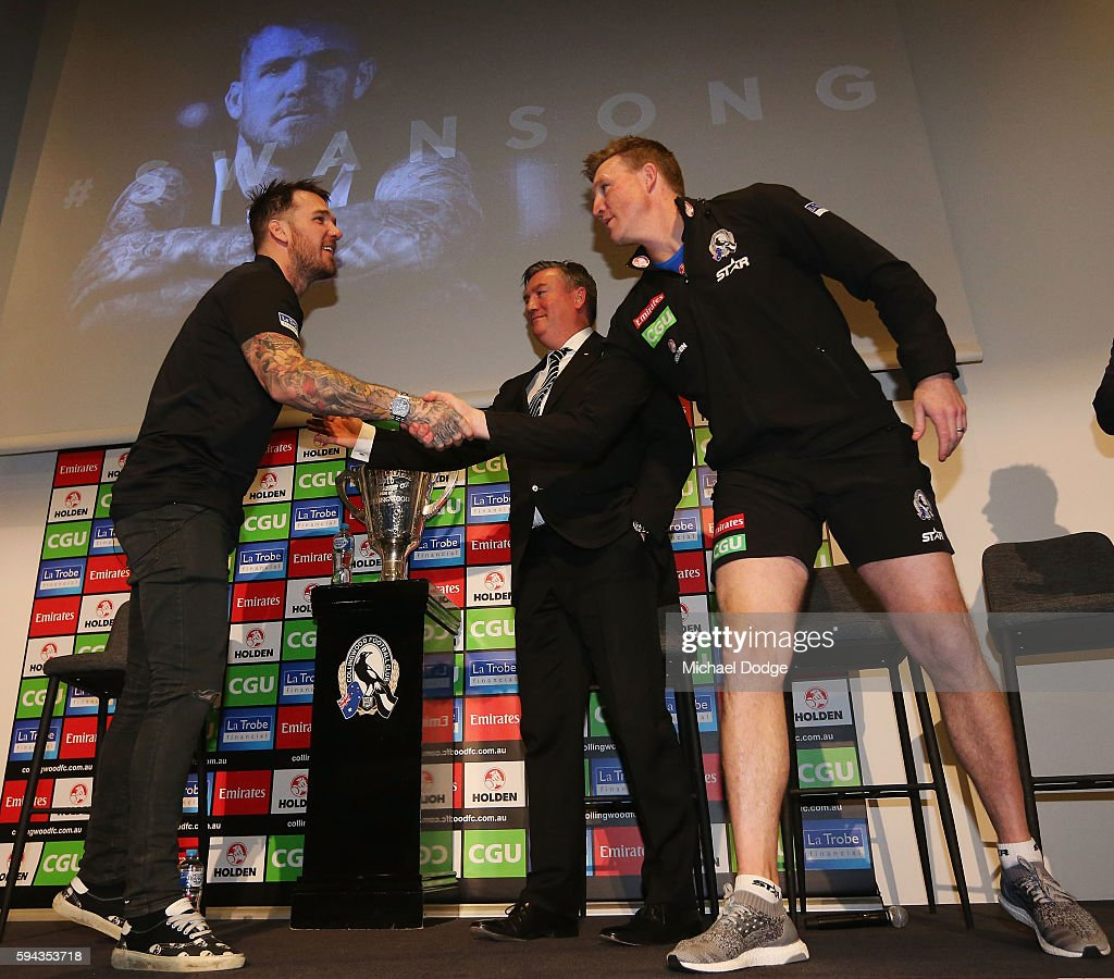 Retiring Dane Swan of the Magpies shakes hands with Magpies President Eddie Maguire and head coach Nathan Buckley during a Collingwood Magpies AFL media session at the Holden Centre on August 23, 2016 in Melbourne, Australia.