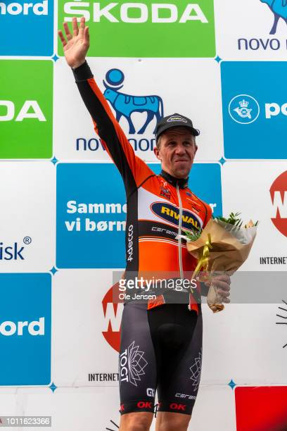 FREDERIKSBERG DENMARK AUGUST 05 Retiring Danish cycling icon Chris Anker Soerensen accepts an award at the podium while waving goodbye to the...