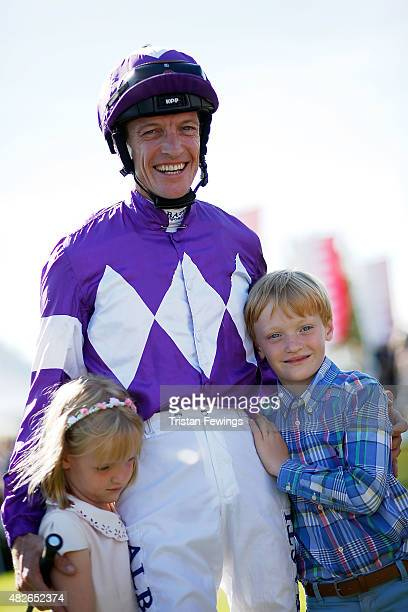 Retiring jockey Richard Hughes with daughter Phoebe and son Harvey on day five of the Qatar Goodwood Festival at Goodwood Racecourse on August 1 2015...