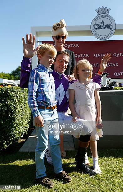 Retiring jockey Richard Hughes with wife Lizzie daughter Phoebe and son Harvey on day five of the Qatar Goodwood Festival at Goodwood Racecourse on...