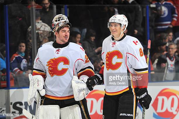 Reto Berra and Joe Colborne of the Calgary Flames celebrate after winning the game against the Edmonton Oilers on March 1 2014 at Rexall Place in...