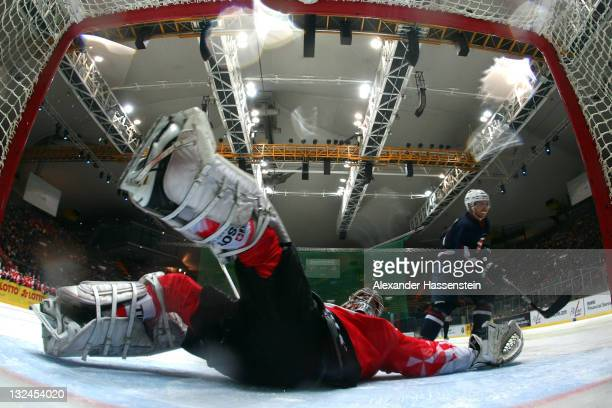 Reto Berra goalie of Switzerland safes the penalty agains Ryan Lasch of the US during 4th match of the German Ice Hockey Cup 2011 between Switzerland...