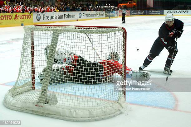 Reto Berra, goalie of Switzerland safes the penalty agains Ryan Lasch of the US during 4th match of the German Ice Hockey Cup 2011 between...