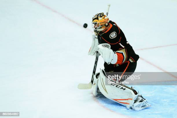 Reto Berra of the Anaheim Ducks blocks a shot during warmups prior to a game against the New York Islanders at Honda Center on October 11 2017 in...