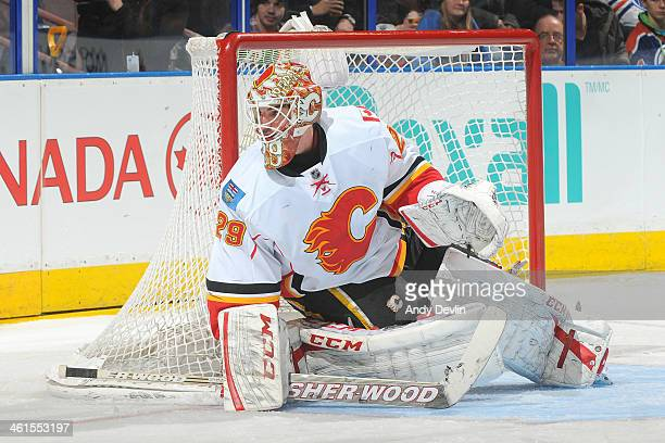 Reto Berra of the Calgary Flames prepares to make a save in a game against the Edmonton Oilers on December 7 2013 at Rexall Place in Edmonton Alberta...