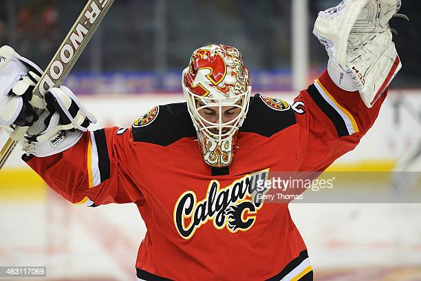 Reto Berra of the Calgary Flames stretches during the warmup before the game against the Winnipeg Jets at Scotiabank Saddledome on January 16 2013 in...