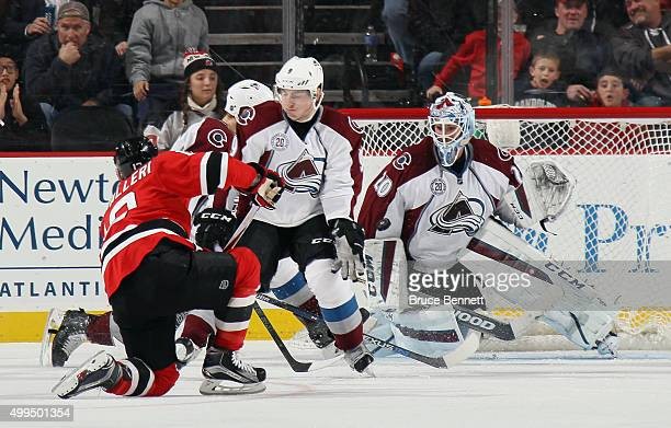 Reto Berra of the Colorado Avalanche makes the third period save on Mike Cammalleri of the New Jersey Devils at the Prudential Center on December 1...