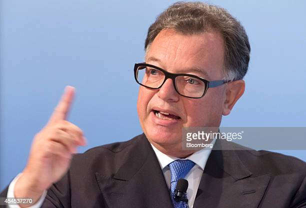 Reto Francioni chief executive officer of Deutsche Boerse AG gestures as he speaks during the Banks In Transition Conference in Frankfurt Germany on...
