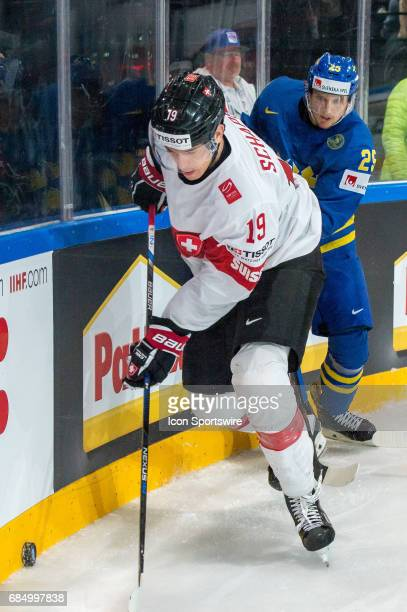 Reto Schappi vies with William Nylander during the Ice Hockey World Championship Quarterfinal between Switzerland and Sweden at AccorHotels Arena in...