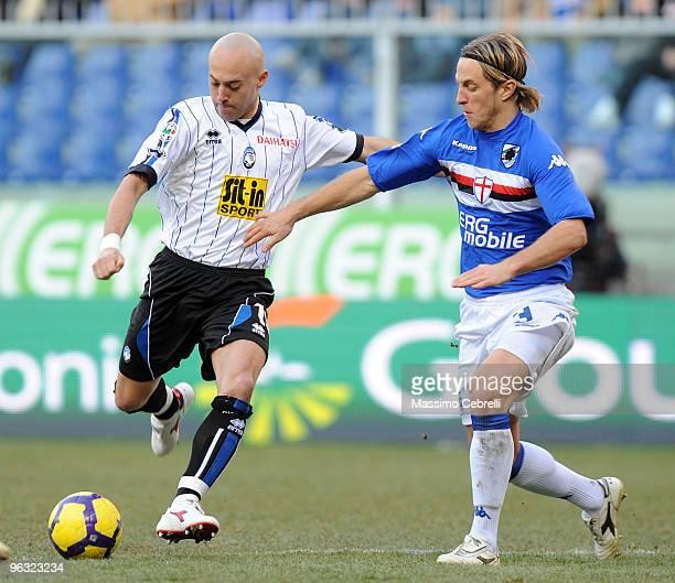 Reto Ziegler of UC Sampdoria battles for the ball against Ernesto Javier Chevanton of Atalanta BC during the Serie A match between UC Sampdoria and...