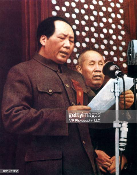Retouched picture released by the Chinese official news agency showing the Chairman Mao Zedong proclaiming 01 October 1949 at the rostrum of...
