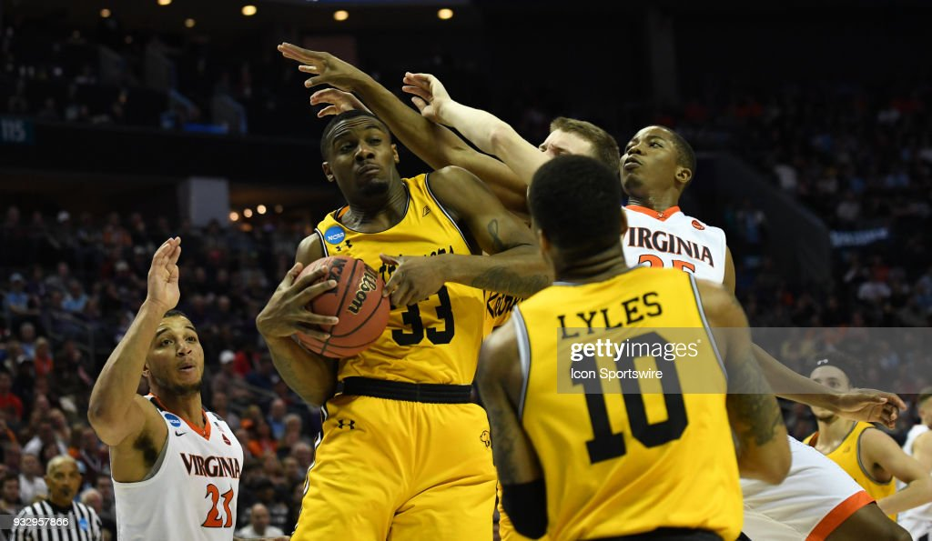 Retrievers forward Arkel Lamar (33) grabs a rebound during the NCAA Division I Men's Championship First Round game between the UMBC Retrievers and the Virginia Cavaliers on March 16, 2018 at the Spectrum Center in Charlotte, NC.