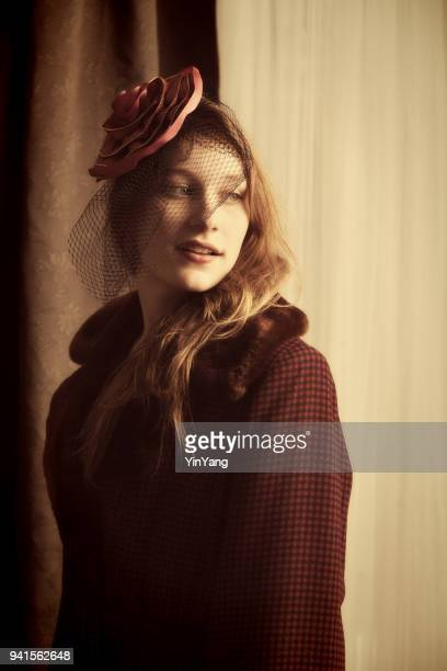 Retro 1930s - 1940s Sepia Fashion Portrait. Young Woman with hat and veil