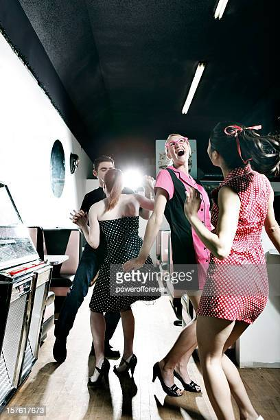 retro 1950's friends dancing by the jukebox in soda shop - cat's eye glasses stock pictures, royalty-free photos & images