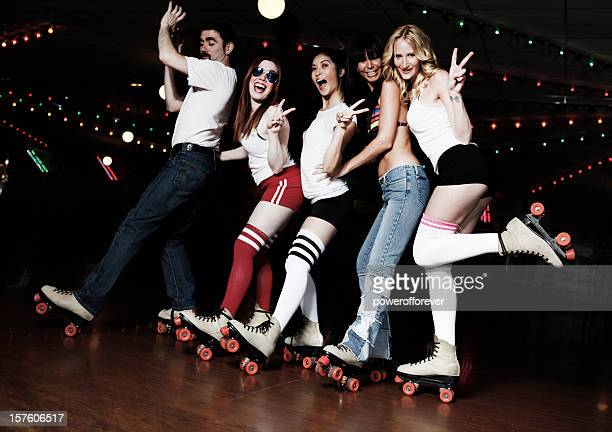retro 70's roller disco conga line - roller skating stock photos and pictures