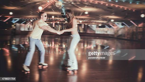 Retro 70's Roller Disco Couple in Blurred Motion