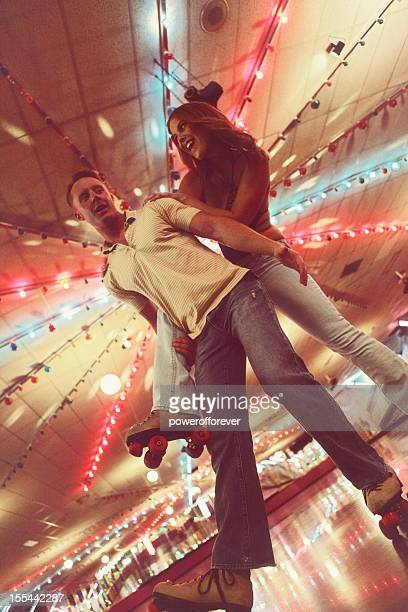 retro 70's roller disco couple - roller rink stock photos and pictures
