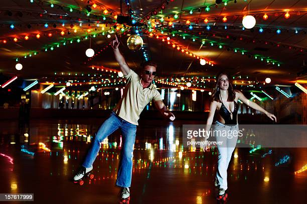 retro 70's roller disco couple - roller skating stock photos and pictures