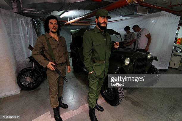 A retro and communism era museum employee shows Fidel Castro and Che Guevara wax figures in the first Museum of communistera in the Black sea town of...