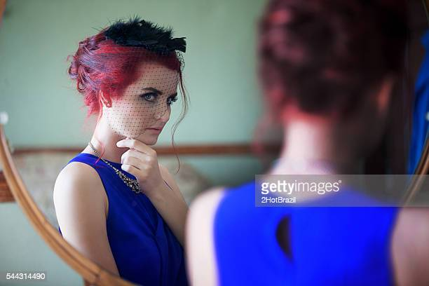 Retro Beautiful Young Woman looking in Mirror
