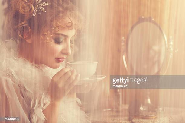 retro beauty drinking coffee in the morning