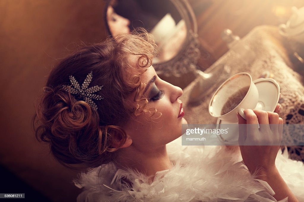 retro beauty drinking tea or coffee in the morning : Stock Photo