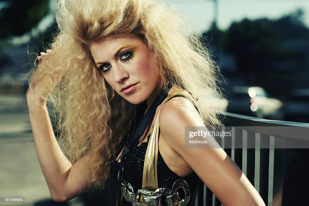 Retro Big Hair Blonde in Gold and Black Outfit : Stock Photo