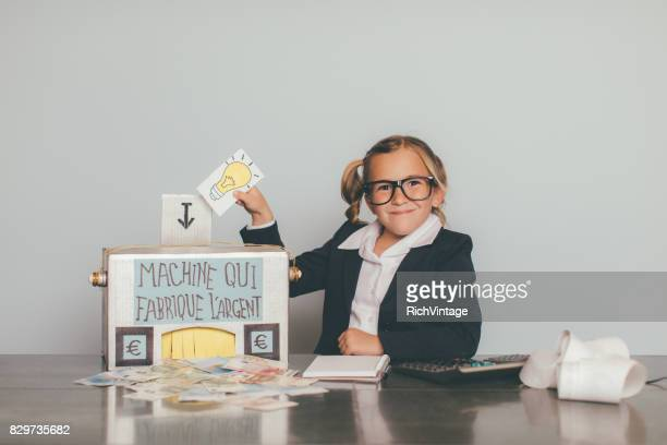 retro business girl is making euros - fun calculator stock photos and pictures