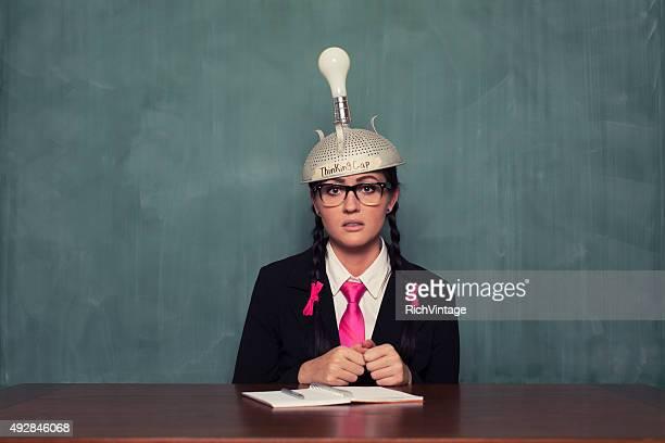 Retro Businesswoman with Thinking Cap is Dazed