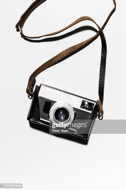retro camera and strap on white background - strap stock pictures, royalty-free photos & images