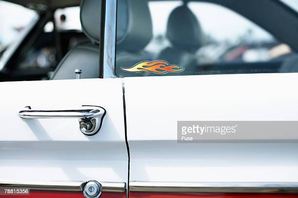 retro car with flames window sticker - customized car stock pictures, royalty-free photos & images