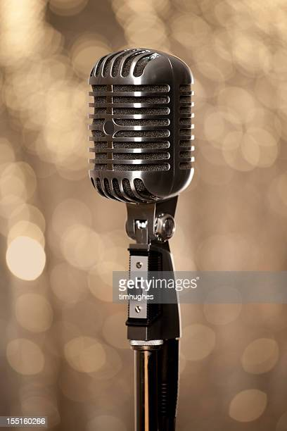 Retro chrome microphone with glamour gold background
