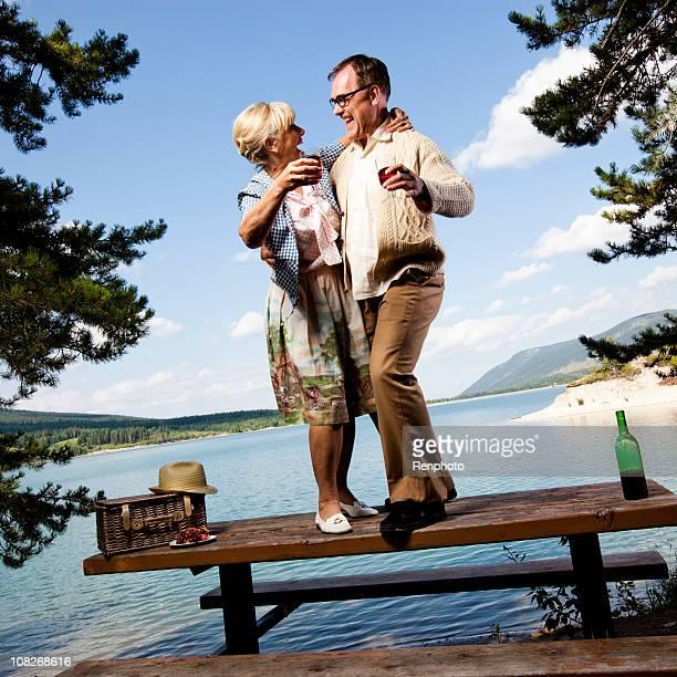 Retro couple dancing on picnic table