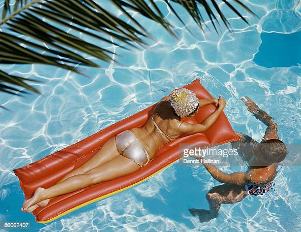 Retro couple enjoying swimming pool