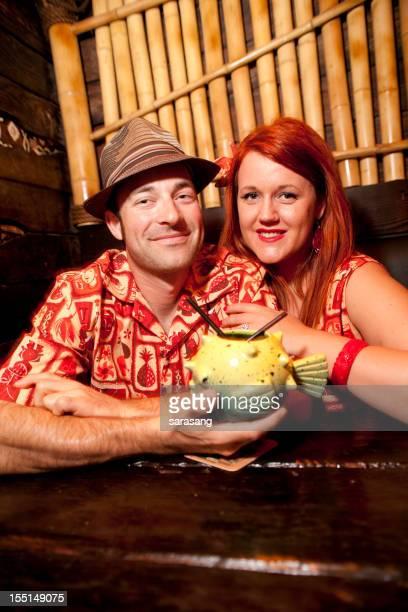 Retro couple in tiki bar