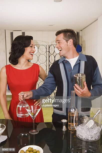 Retro couple making cocktails
