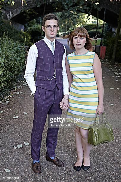 Retro couple stood together on a footpath