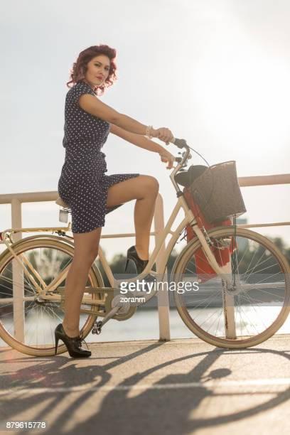 Retro dressed woman on bike