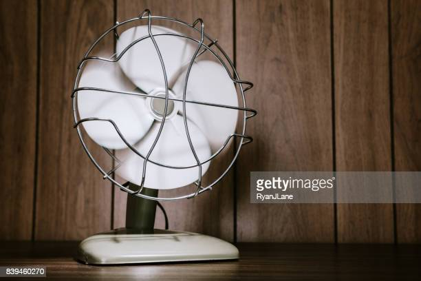 Retro Electric Fan and Wood Paneling