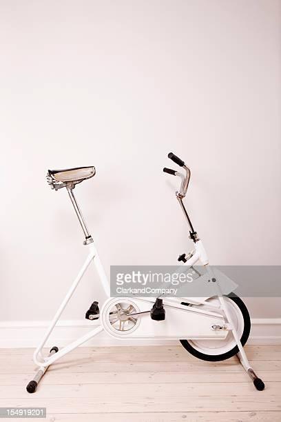 Retro Exercise Bike Against a Neutral Coloured  Wall