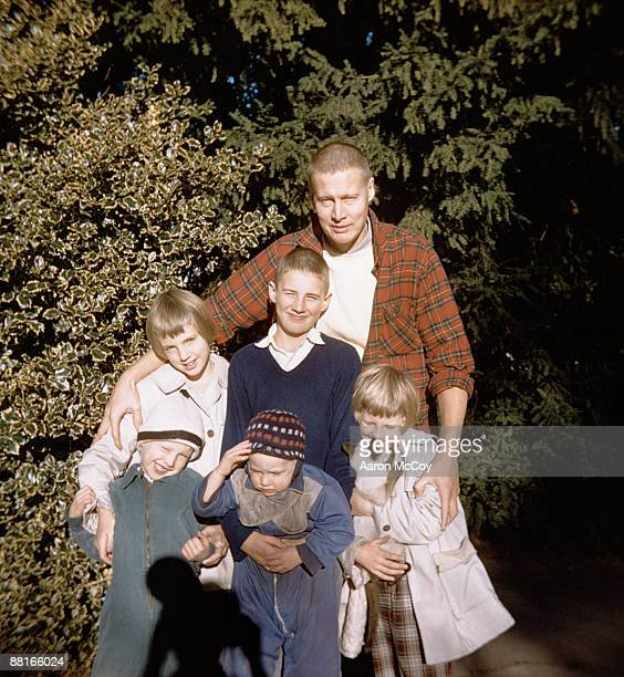 Retro father posing and hugging children