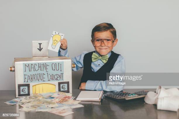 retro french business boy making euros - fun calculator stock photos and pictures