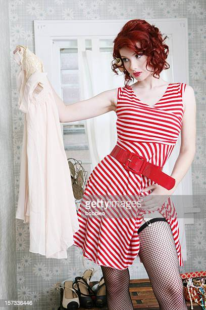 retro getting dressed - striped dress stock photos and pictures