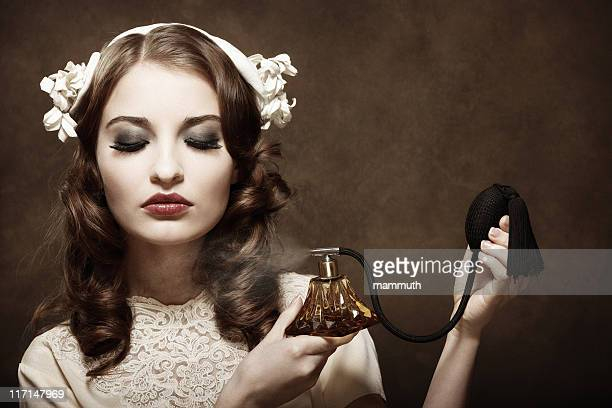 Retro girl applying perfume