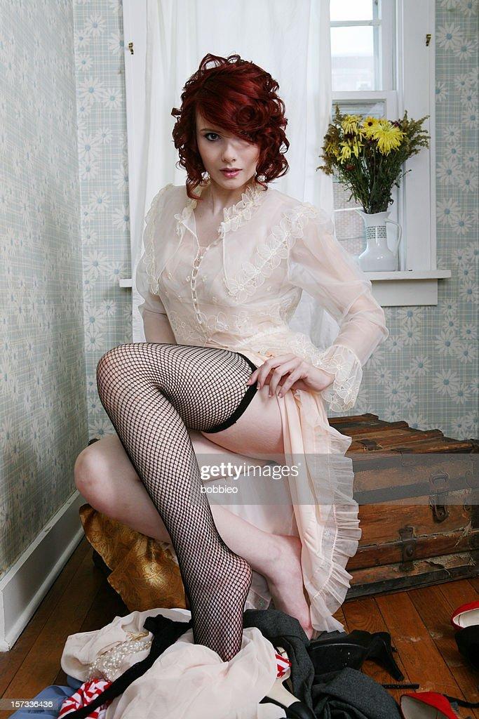 Retro Girl Getting Dressed : Stock Photo
